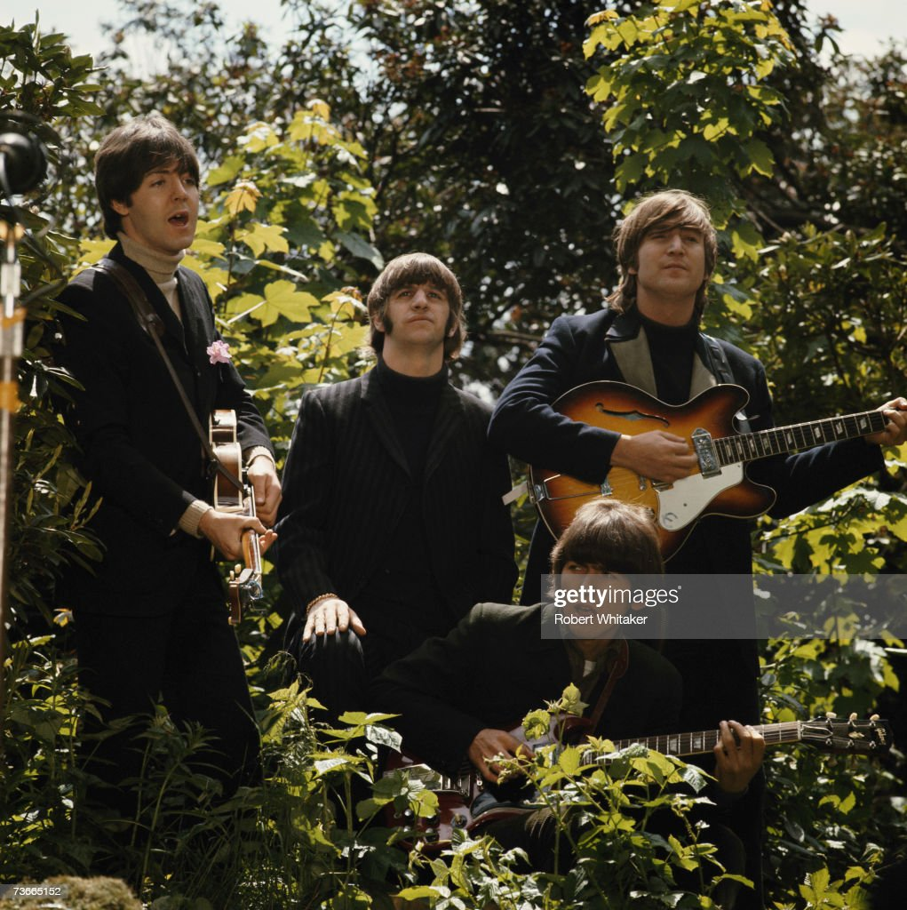 The Beatles in Chiswick House grounds, London, during the making of promotional films for their single 'Rain' and 'Paperback Writer', 20th May 1966. Left to right: Paul McCartney, Ringo Starr, <a gi-track='captionPersonalityLinkClicked' href=/galleries/search?phrase=George+Harrison&family=editorial&specificpeople=90945 ng-click='$event.stopPropagation()'>George Harrison</a> (1943 - 2001) John Lennon (1940 - 1980).