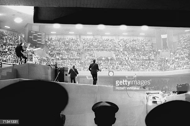 The Beatles in performance during their first show at Tokyo's Budokan Hall 30th June 1966
