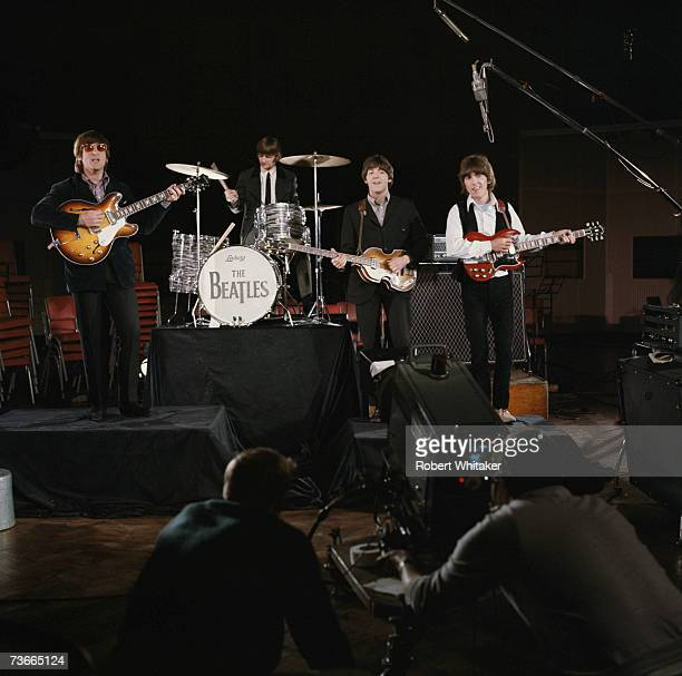 The Beatles John Lennon Ringo Starr Paul McCartney and George Harrison being filmed for a promotional video for their single 'Paperback Writer' and...