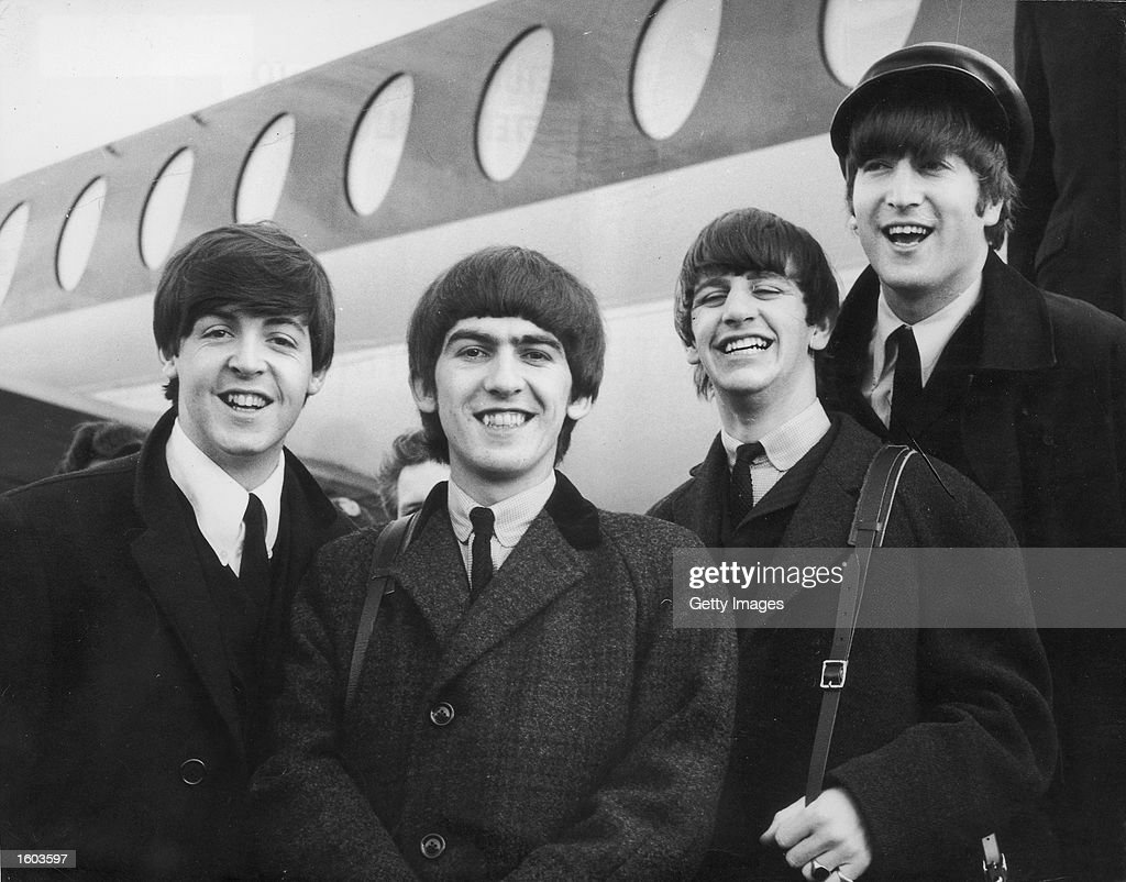 The Beatles, left to right, Paul McCartney, George Harrison, Ringo Starr and John Lennon (1940 - 1980) arrive at London Airport February 6, 1964, after a trip to Paris. Conflicting reports were released July 23, 2001 regarding Beatle George Harrison''s battle with cancer. Music producer Sir George Martin was quoted as saying that Harrison expects to die soon from his illnesses. The 58-year-old musician underwent treatment for a brain tumor at a clinic in Switzerland, and had surgery earlier this year for lung cancer.