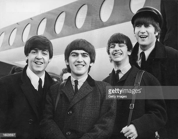 The Beatles left to right Paul McCartney George Harrison Ringo Starr and John Lennon arrive at London Airport February 6 after a trip to Paris...