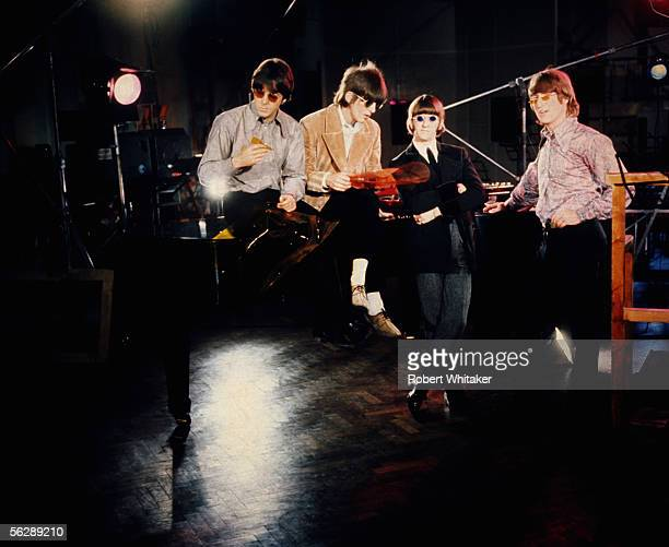 The Beatles left to right Paul McCartney George Harrison Ringo Starr and John Lennon during the Abbey Road session to record Paperback Writer and...