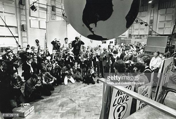 The Beatles line up for the press at EMI Studios in Abbey Road London for the 'One World' global TV satellite link up programme on which they...