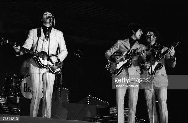 The Beatles on stage at Tokyos Budokan Hall from left to right Paul McCartney George Harrison and John Lennon Japan July 1st 1966