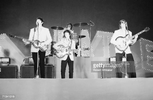 The Beatles on stage at Tokyos Budokan Hall Japan 2nd July 1966 From left to right Paul McCartney George Harrison Ringo Starr John Lennon