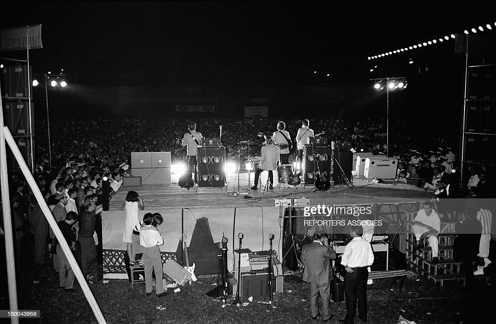 The Beatles on stage on June 28, 1965 in Rome, Italy.