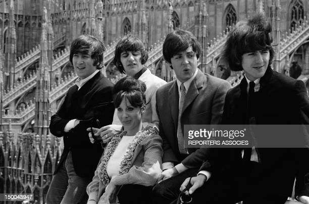 The Beatles on the rooftop of their hotel facing the Duomo on June 24 1965 in Milan Italy
