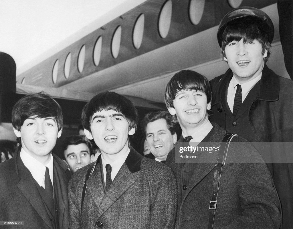 Paul McCartney; George Harrison, Ringo Starr, and John Lennon on their arrival in 1964 at Heathrow Airport from Paris where they appeared at the Olympia Music Hall. More than 100 fans and a strong police escort were on hand to meet the young men.