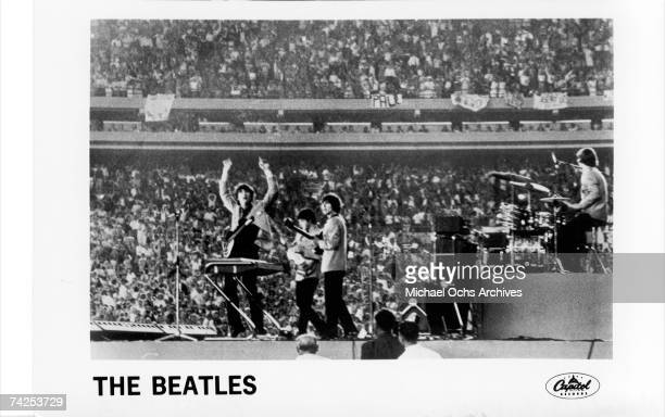 The Beatles perform at Shea Stadium New York on 15th August 1965 John Lennon Paul McCartney George Harrison Ringo Starr