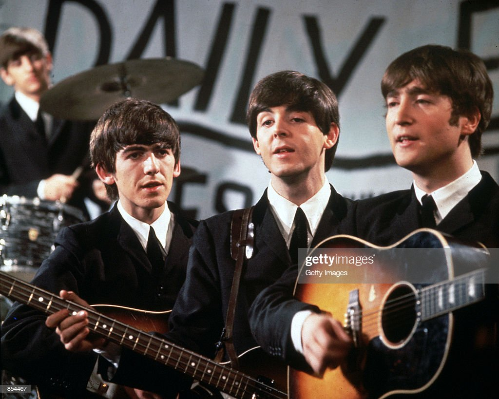 The Beatles perform in November 1963. 58 year old ex-Beatle band member George Harrison died of cancer November 30, 2001 in Los Angeles, California.