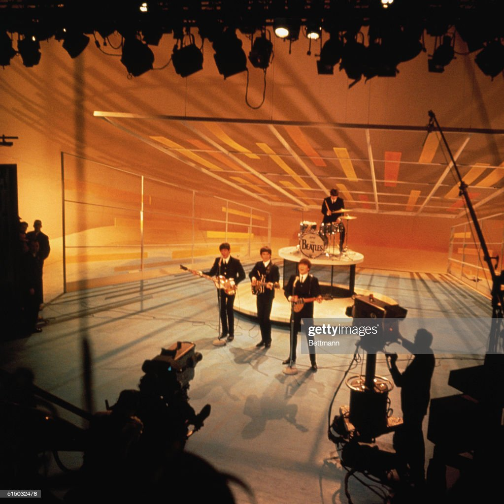 <a gi-track='captionPersonalityLinkClicked' href=/galleries/search?phrase=The+Beatles&family=editorial&specificpeople=90369 ng-click='$event.stopPropagation()'>The Beatles</a> performing during their nationwide television debut on The Ed Sullivan Show from CBS television studios in Manhattan.