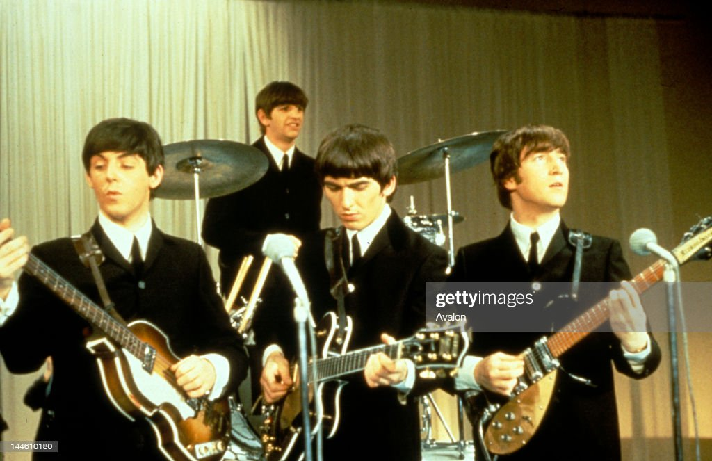 <a gi-track='captionPersonalityLinkClicked' href=/galleries/search?phrase=The+Beatles&family=editorial&specificpeople=90369 ng-click='$event.stopPropagation()'>The Beatles</a> performing on stage, circa 1963. Left to right: <a gi-track='captionPersonalityLinkClicked' href=/galleries/search?phrase=Paul+McCartney&family=editorial&specificpeople=92298 ng-click='$event.stopPropagation()'>Paul McCartney</a>, <a gi-track='captionPersonalityLinkClicked' href=/galleries/search?phrase=Ringo+Starr&family=editorial&specificpeople=92463 ng-click='$event.stopPropagation()'>Ringo Starr</a>, <a gi-track='captionPersonalityLinkClicked' href=/galleries/search?phrase=George+Harrison&family=editorial&specificpeople=90945 ng-click='$event.stopPropagation()'>George Harrison</a> (1943 - 2001) and <a gi-track='captionPersonalityLinkClicked' href=/galleries/search?phrase=John+Lennon&family=editorial&specificpeople=91242 ng-click='$event.stopPropagation()'>John Lennon</a> (1940 - 1980).