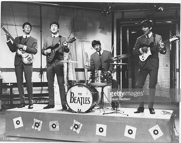 The Beatles bassist Paul McCartney guitarist John Lennon drummer Ringo Starr and guitarist George Harrison performing on the set of ITV music show...