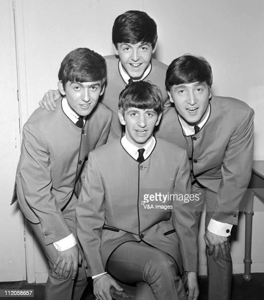 The Beatles pose for an early group portrait wearing Pierre Cardin collarless jackets George Harrison Paul McCartney John Lennon Ringo Starr 1963