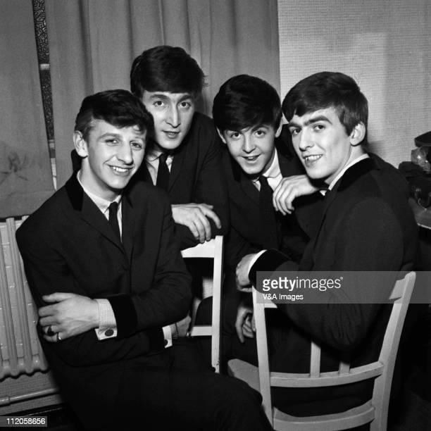 The Beatles pose for an eraly group portrait backstage Ringo Starr John Lennon Paul McCartney George Harrison 1962