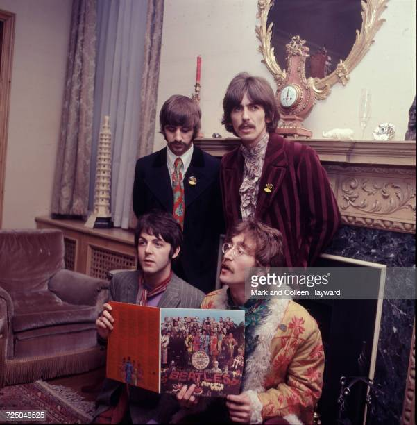The Beatles pose for the press with their newly completed album 'Sergeant Pepper's Lonely Hearts Club Band' at the press launch for the album held at...