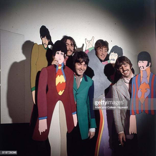 The Beatles posed with cardboard cutouts of their 'Yellow Submarine' characters at TVC animation Studios in London 6th November 1967 LR George...