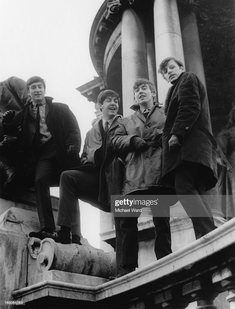 The Beatles posing on the Victoria Monument in Derby Square, Liverpool, 1st February 1963. Left to right: John Lennon (1940 - 1980), Paul McCartney, George Harrison (1943 - 2001) and Ringo Starr.