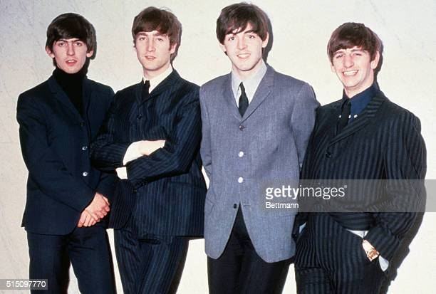 The Beatles posing together From left to right musicians George Harrison John Lennon Paul McCartney and Ringo Starr circa 1965