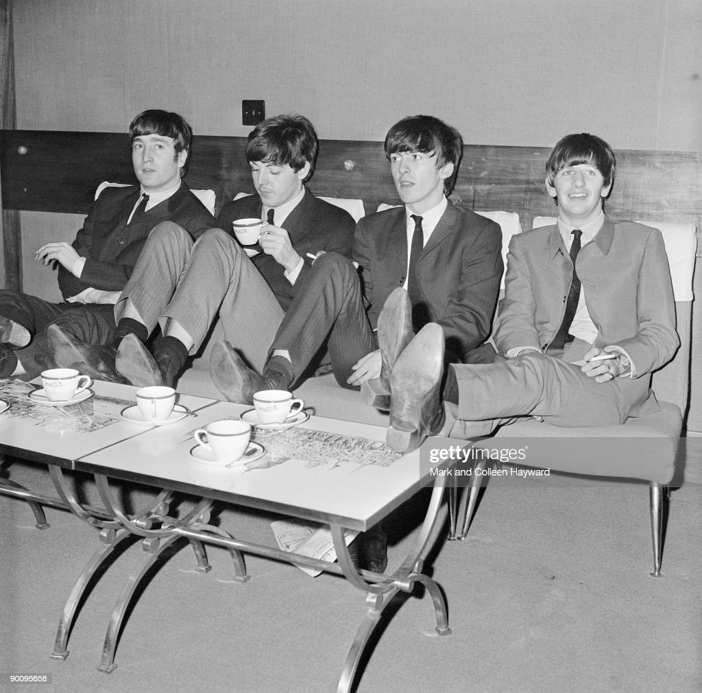 The Beatles relax backstage at London's Prince of Wales Theatre, before the Royal Variety Performance, 4th November 1963. They are supporting Marlene Dietrich in the show.