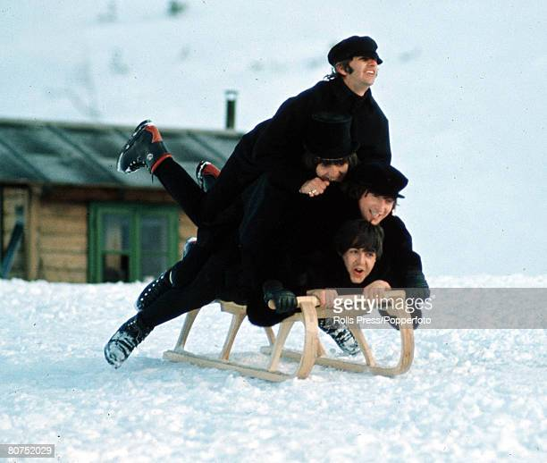The Beatles Ringo Starr George Harrison John Lennon and Paul McCartney all piled on top of a sledge in the snow during the making of their second...