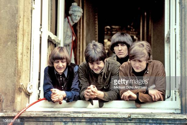 ENGLAND The Beatles Ringo Starr Paul McCartney George Harrison and John Lennon at a window of Cliveden House in Buckinghamshire during the filming of...