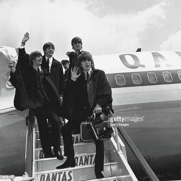 The Beatles Ringo Starr Paul McCartney John Lennon and George Harrison wave to fans July 2 1964 as they return to London from a tour of Australia It...
