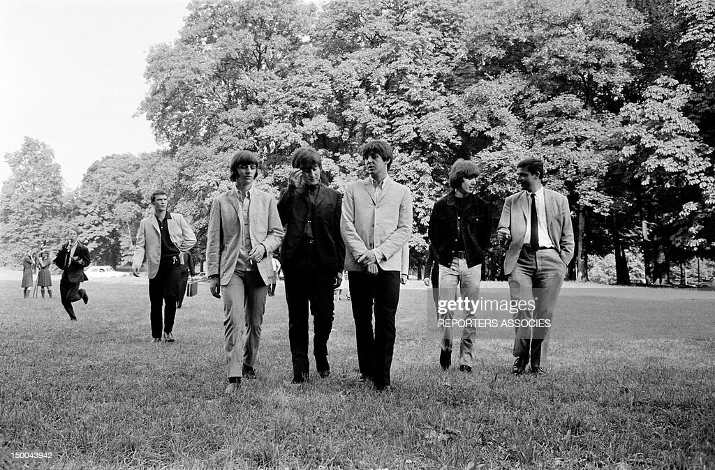 The Beatles strolling in a Paris park on June 23, 1965 in Paris, France.