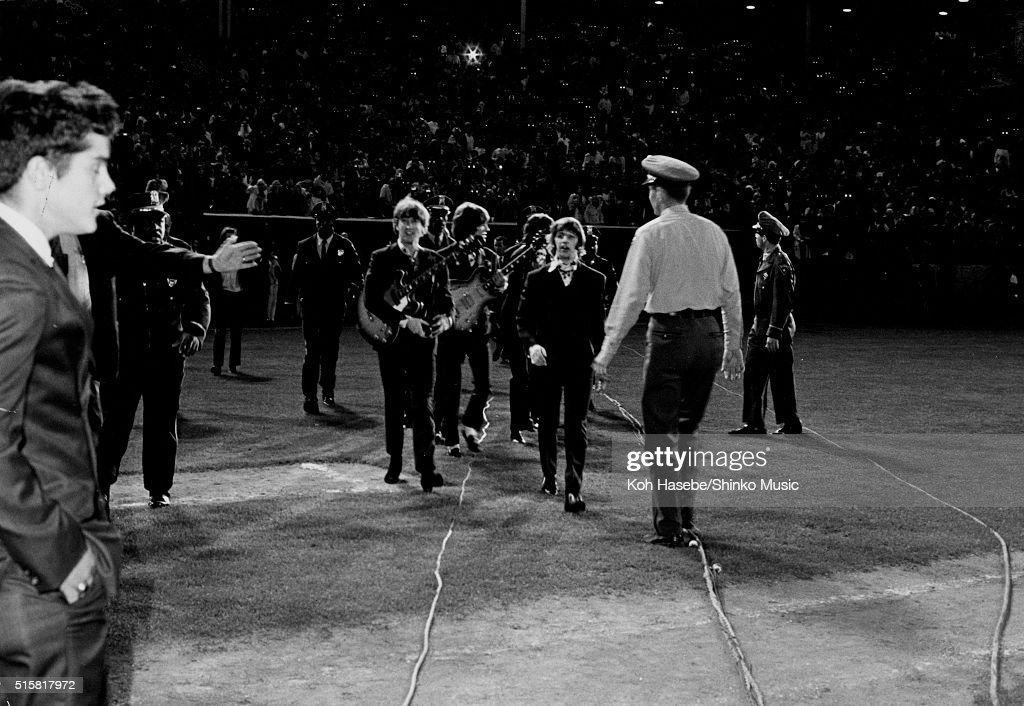 The Beatles walking to the stage for the last show of their final tour at Candlestick Park San Francisco California August 29 1966