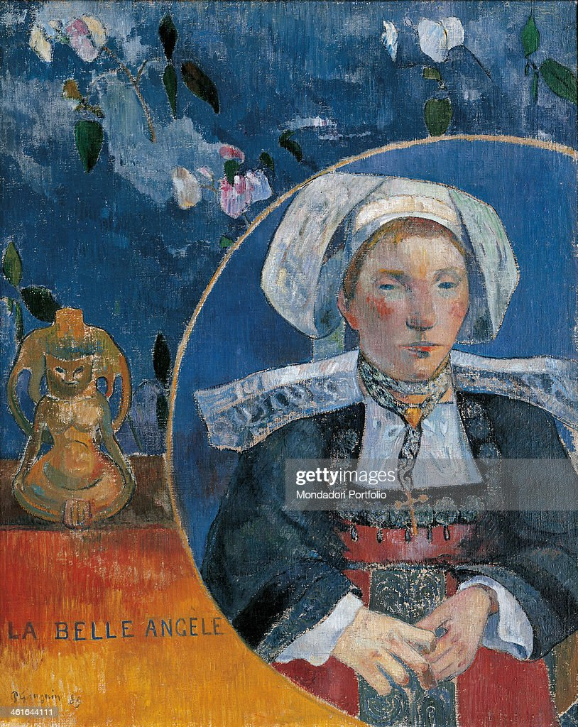 The beautiful Angèle, by <a gi-track='captionPersonalityLinkClicked' href=/galleries/search?phrase=Paul+Gauguin&family=editorial&specificpeople=99058 ng-click='$event.stopPropagation()'>Paul Gauguin</a>, 1889, 19th Century, oil on canvas. France, Paris, Musée d'Orsay. Whole artwork view. Portrait of woman in traditional clothes in a circle on a table with a little statue and a floral background.