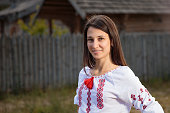 The beautiful girl in National Ukrainian Costume in park