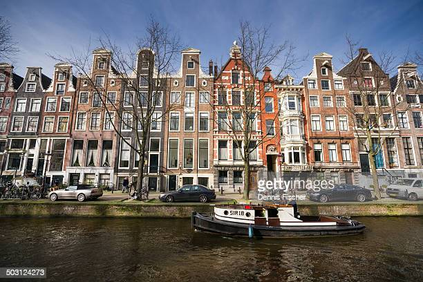 CONTENT] The beautiful houses and canals of Amsterdam