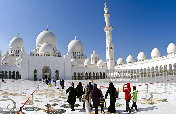 The beautiful interior of the white Sheikh Zayed Grand Mosque in Abu Dhabi in the UAE the worlds 8th largest Muslim mosque in the world with Muslim...