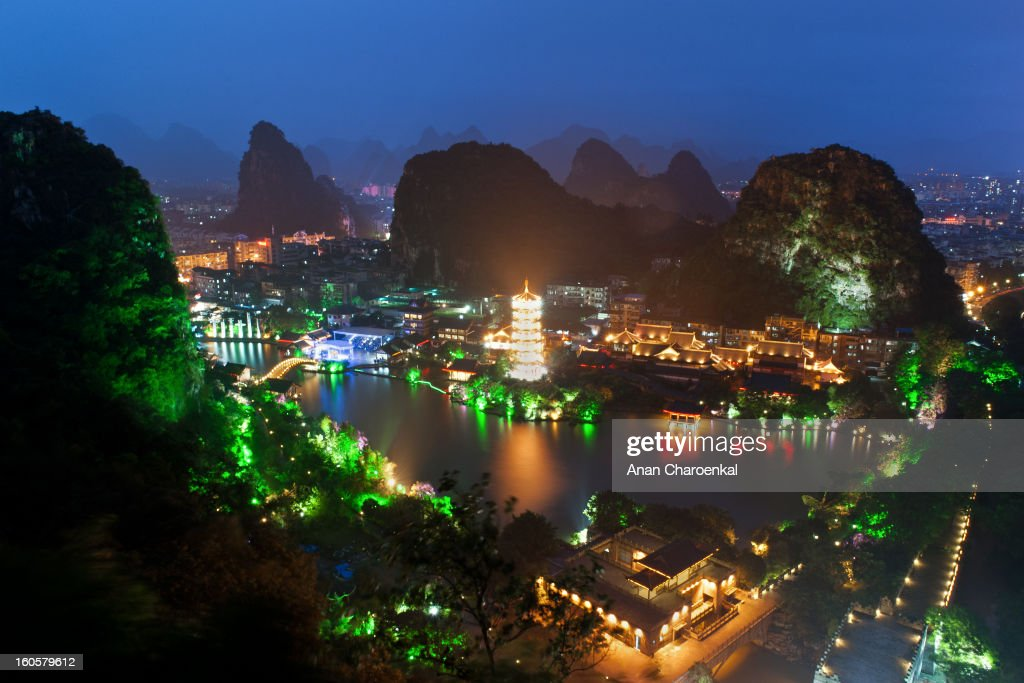 CONTENT] The beautiful landscape photo of Guillin. Illustration with Pagoda limestone mountains and lakes.