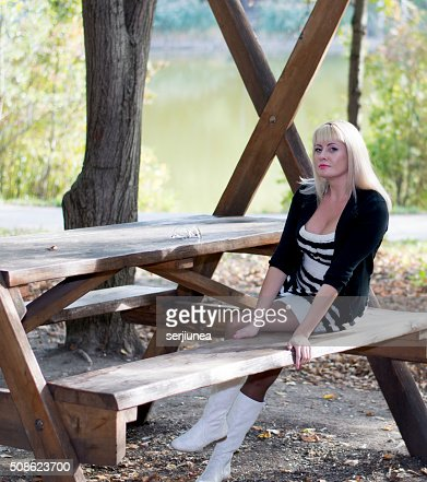 the beautiful woman on vacation at the lake, fall : Stock Photo