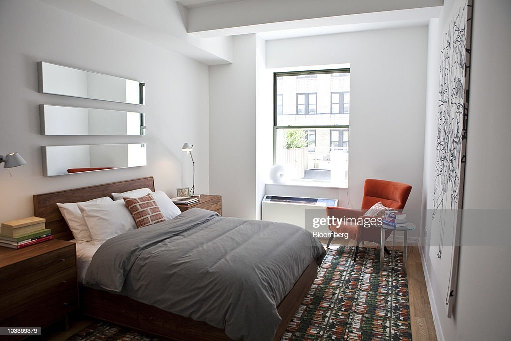 The bedroom of a model one-bedroom apartment is pictured at the 99 John Deco Loft condo building in New York, U.S., on Friday, July 30, 2010. In March, the Federal Housing Administration (FHA) agreed to insure mortgages made at the 442-unit conversion project, allowing buyers to acquire an apartment with a down payment of as little as 3.5 percent. The development had 10 units go into contract with FHA backing, but the agency suspended its support for the building on August 3. Photographer: Ramin Talaie/Bloomberg via Getty Images