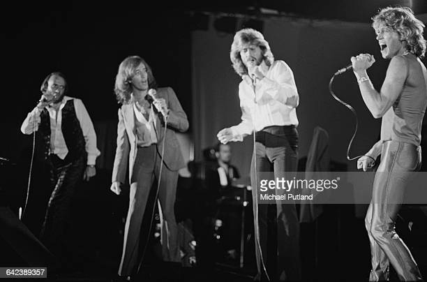 The Bee Gees and their younger brother Andy Gibb performing at the NARM convention and award ceremony at the Diplomat Hotel in Hollywood Florida...