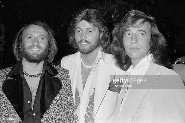 brothers Maurice Gibb Barry Gibb Robin Gibb at a party celebrating their 20th Anniversary as a vocal group