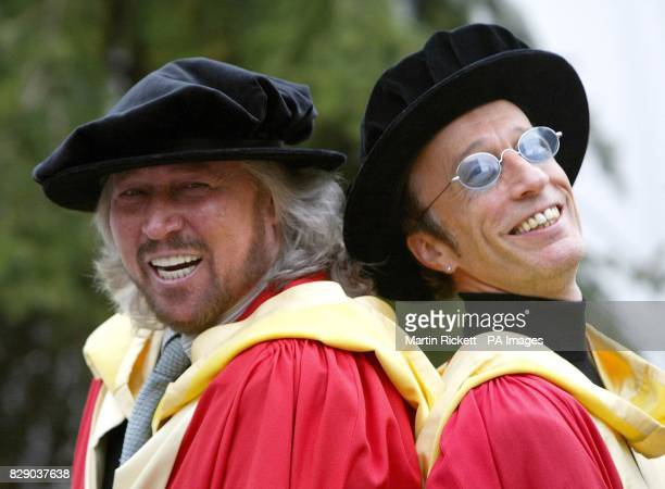 The Bee Gees Barry and Robin Gibb pose for photographers after recieving honorary degree's at The University of Manchester The brothers also accepted...