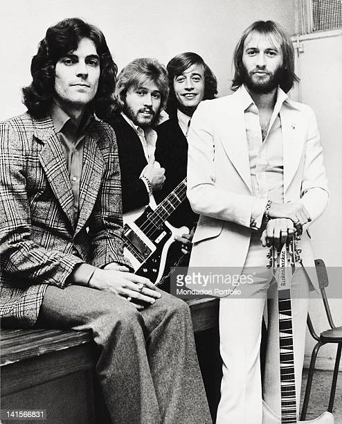 The Bee Gees musical group posing with a bass and a guitar The band is composed by the three English brothers and musicians Barry Robin and Maurice...
