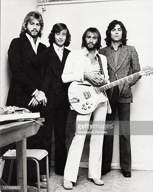 The Bee Gees musical group posing with a guitar The band is composed by the three English brothers and musicians Barry Robin and Maurice Gibb with...
