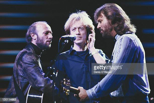 The Bee Gees performing on stage circa 1985 Left to right Maurice Gibb Robin Gibb and Barry Gibb