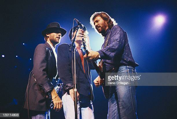 The Bee Gees performing on stage circa 1990 Left to right Maurice Gibb Robin Gibb and Barry Gibb