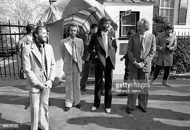 The Bee Gees pose with their manager Maurice Gibb Robin Gibb Barry Gibb and manager Robert Stigwood in 1976 in New York