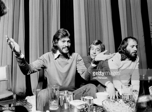 The Bee Gees posed at a Press Conference in Copenhagen Denmark in 1975 LR Barry Gibb Robin Gibb Maurice Gibb