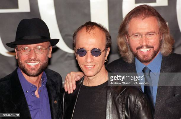 The Bee Gess Maurice Robin and Barry Gibb pose for the media during a photocall at London's Cafe Royal where they unveiled plans for a leisurely...
