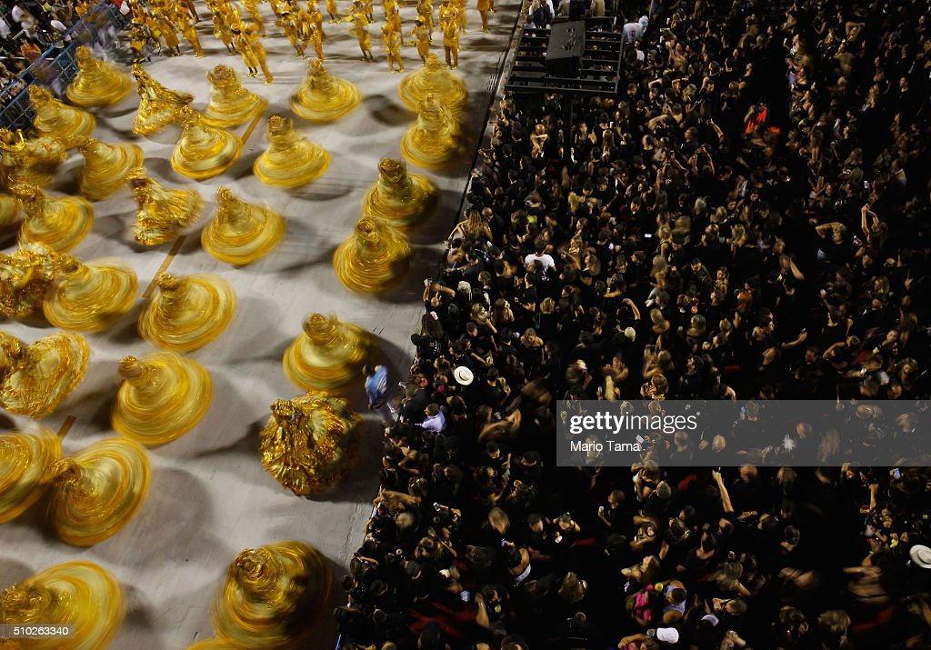 The BeijaFlor samba school parades and are blurred in a long exposure in the Sambodrome at the Champion's Parade on February 14 2016 in Rio de...