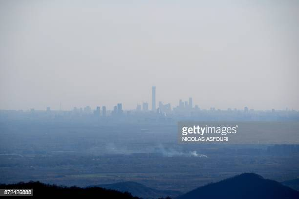 The Beijing skyline is seen from the Great Wall of China ahead of the arrival of US First Lady Melania Trump on the outskirts of Beijing on November...