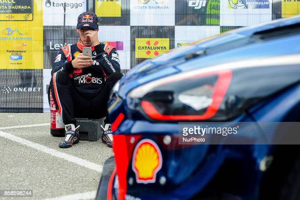 The Belgian driver Thierry Neuville watching his smartphone before crash his Hyundai i20 wrc car during the second day of the Rally Racc Catalunya...
