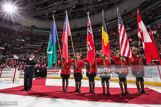 The Belgian flag is included in the color guard during the singing of the national anthems prior to an NHL game between the Ottawa Senators and the...
